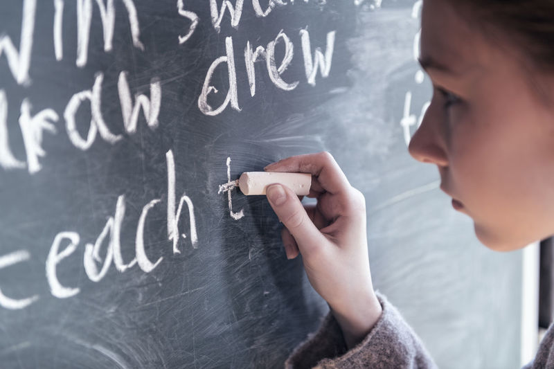 Beautiful young woman's hand holding piece of chalk on blackboard background. Girl's face near the blackboard. Girl thinking. School concept. Portrait Childhood Real People Learn Elementary Back SchoolGirl Pupil White Emotion Concept Caucasian Student Young Women Piece Holding Girl Hair Hand Chalk Drawing Chalkboard Chalk Blackboard School Questions Question Summer Plans Future Complexity Elementary School Effort Studying Intelligence Teacher Teaching Child Formula One Person Writing Symbol Indoors  Classroom School Learning Board Blackboard  Education Blackboard  Indoors  English