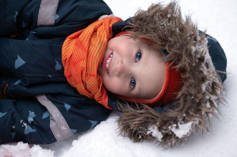 Portrait of boy in snow during winter