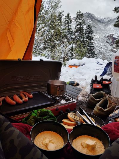 High angle view of food on table against mountain during winter
