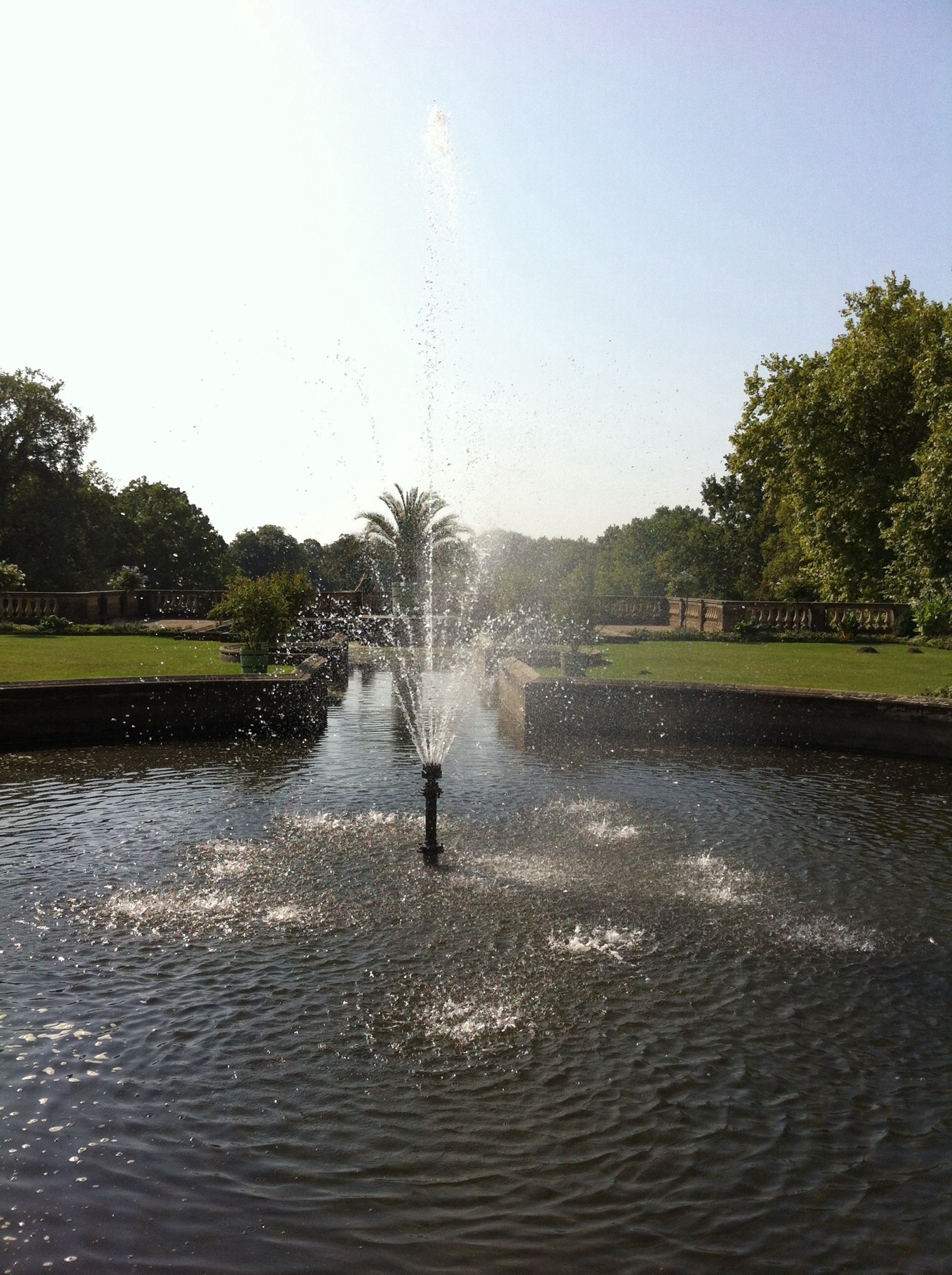 water, tree, clear sky, waterfront, lake, motion, reflection, nature, fountain, splashing, sky, beauty in nature, scenics, spraying, river, lifestyles, leisure activity, rippled
