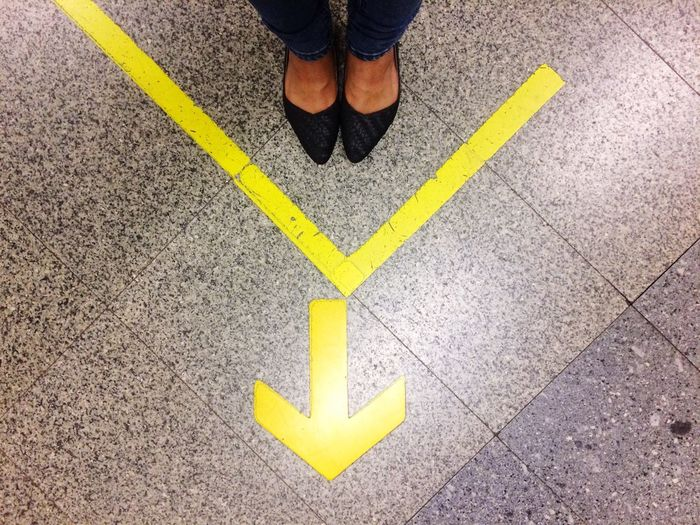 Foot Yellow Guidance One Person Asphalt The Way Forward People Day Outdoors Only Men One Man Only Yellow LINE Arrow