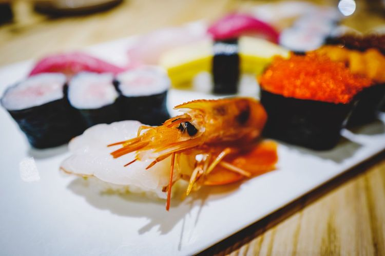 Dinner Japanese Food Sushi Shrimp Close-up Animal Indoors  Focus On Foreground No People Seafood Animal Themes Animal Wildlife Table Fish Food And Drink Selective Focus Freshness Still Life Food Ready-to-eat Vertebrate One Animal Plate Crustacean
