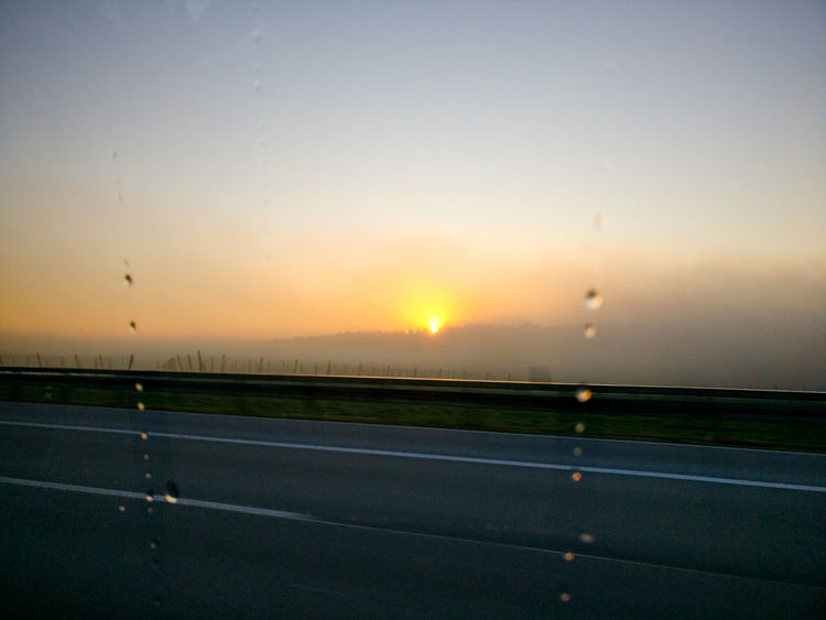 Roadtrip Drops Driving Under The Rain Sunrise From The Car Window Sun Sky No People Outdoors Beauty In Nature Sport Rural Scene Road Landscape Transportation