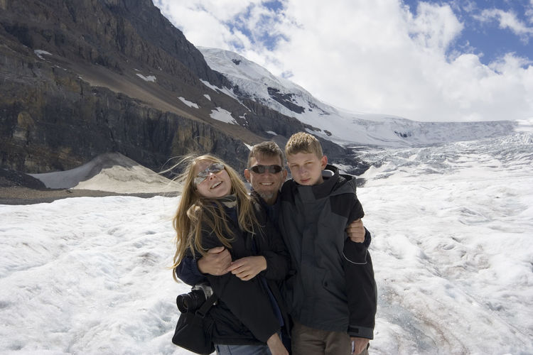 father and kids in the rockies - athabasca glacier, jasper national park, canada Beauty In Nature Bonding Canada Cold Temperature Exploring Family Family❤ Fatherhood Moments Glacier Happiness Kids Looking At Camera Love Man Mountain Portrait Rocky Mountains Smiling Snow Three People Togetherness Vacations Warm Clothing Winter Winter
