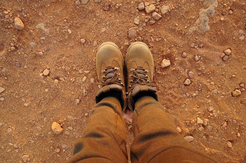 My boots and pants become brown after a walk in desert. Pants Boot Desert Shoe Low Section Human Leg Body Part One Person Human Body Part Personal Perspective Directly Above Land Standing Sand My Best Travel Photo My Best Travel Photo
