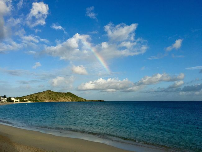 Sea Beach Scenics Horizon Over Water Tranquil Scene Water Beauty In Nature Sky Tranquility Nature Cloud - Sky Day Outdoors Sand No People Blue Rainbow