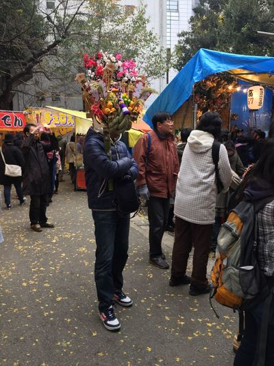 """Enjoy The New Normal Japanese Culture Discover Your City Tadaa Community Traveling Check This Out The Purist (no Edit, No Filter) Unique Festival A man has just bought a new year decoration at so called """" Bird Day fair"""". 熊手 酉の市"""