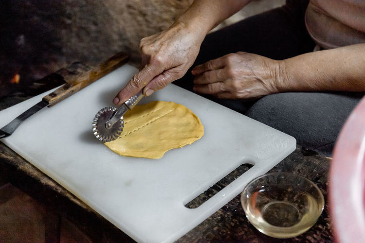 The preparation of a traditional food, sweet fritter called filhós from portugal. christmas time.