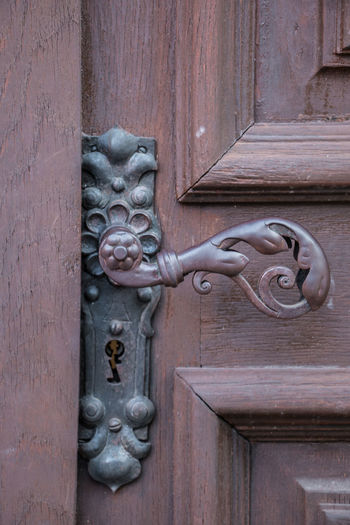 Iron door handle of an old door of a historical building Door Entrance Wood - Material Metal No People Day Security Protection Door Knocker Safety Knob Art And Craft Doorknob Close-up Animal Representation Craft Representation Closed Creativity Building Exterior Outdoors Ornate