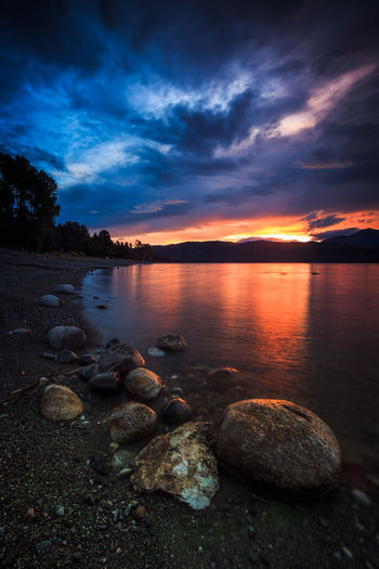 Lake Te Anau Beach Beauty In Nature Cloud - Sky Idyllic Land Nature New Zealand No People Non-urban Scene Orange Color Outdoors Pebble Rock Rock - Object Scenics - Nature Sea Sky Solid South Island Summer Sunset Tranquil Scene Tranquility Water