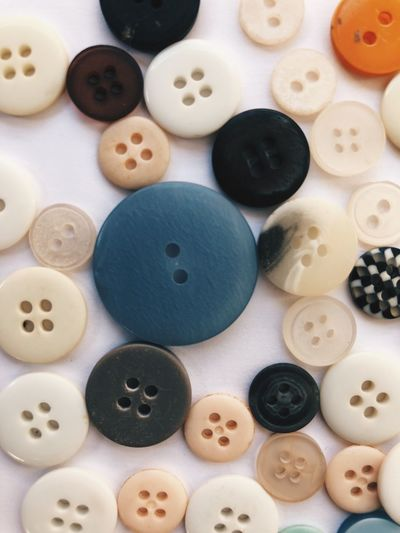 Closeup of a buttons Still Life Variation Table Close-up Indoors  Choice No People Large Group Of Objects Button Day