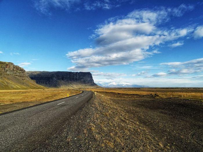 Lonely Iceland roads Iceland Skyline EyeEmNewHere Road Sky Landscape Cloud - Sky Empty Road Asphalt Mountain Road Yellow Line Roadways Winding Road