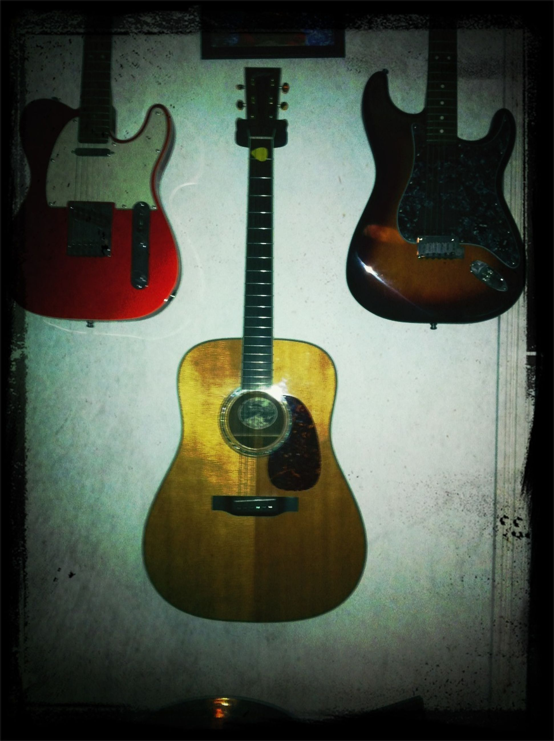 indoors, transfer print, auto post production filter, close-up, still life, metal, music, wall - building feature, musical instrument, table, single object, arts culture and entertainment, technology, no people, old-fashioned, electricity, wood - material, guitar, hanging, home interior