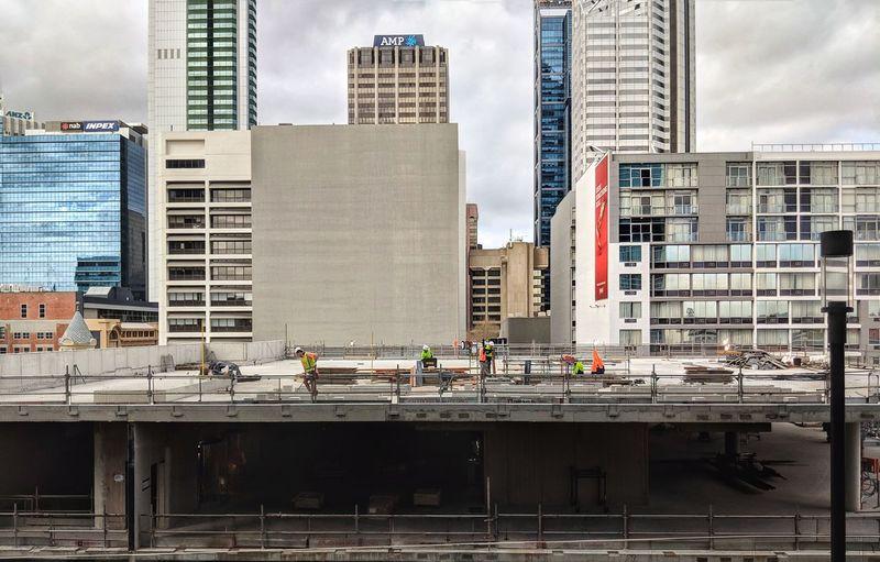 Under construction. City Skyscraper Modern Urban Skyline Construction Site Water Sky Architecture Building Exterior Built Structure Construction