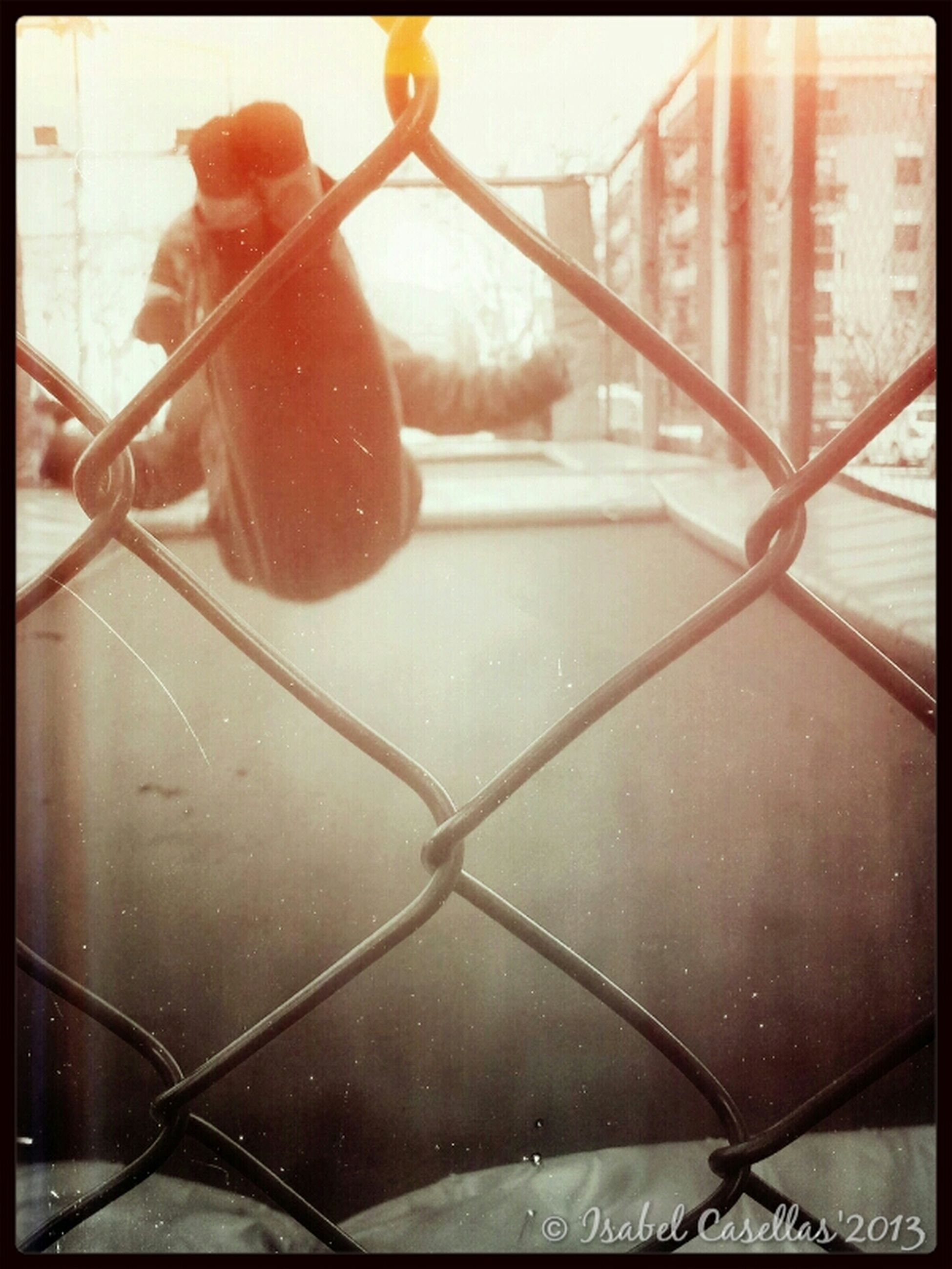 transfer print, metal, auto post production filter, close-up, water, chainlink fence, metallic, protection, safety, railing, fence, day, built structure, rusty, no people, outdoors, drop, wet, architecture, security