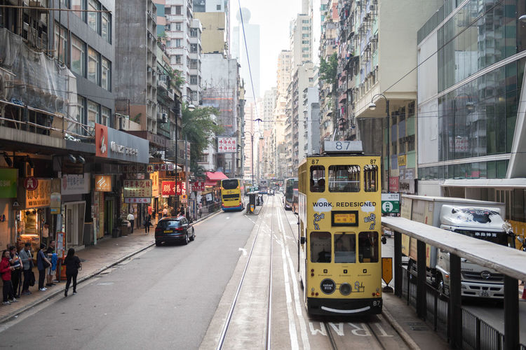 Hong Kong is an autonomous territory, and former British colony, in southeastern vibrant, densely populated urban centre is a major port and global financial hub with a skyscraper-studded (the business district) features architectural landmarks like 's Bank of China Kong is also a major shopping destination, famed for bespoke tailors and Temple Street Night Market. Architecture Building Exterior Built Structure Bus Cable Car Car City City Life City Street Day Incidental People Land Vehicle Mode Of Transportation Motion Motor Vehicle Outdoors Public Transportation Rail Transportation Road School Bus Street Streetphotography Track Transportation The Street Photographer - 2018 EyeEm Awards