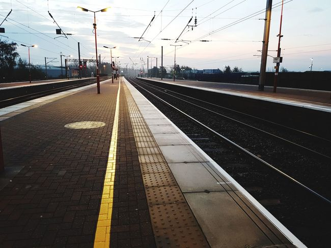 Waiting to go to London Railroad Track Transportation Rail Transportation Railroad Station Public Transportation Railroad Station Platform Mode Of Transport Sky Cloud - Sky Travel Arrival Outdoors Sunset Day No People Nature