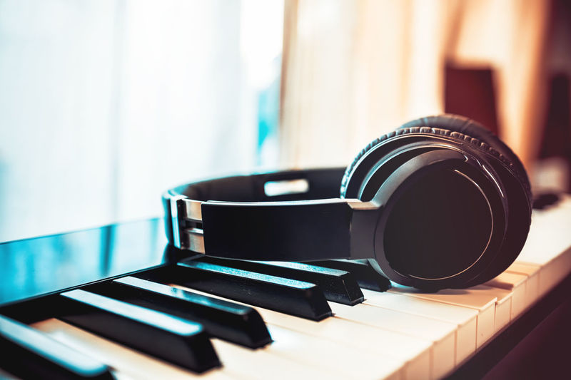 Bluetooth headphone on piano keyboard