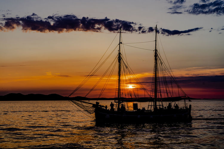 the best sunset in the world, they say... Beauty In Nature Cloud - Sky Mast Mode Of Transportation Nature Nautical Vessel No People Orange Color Outdoors Pole Sailboat Sailing Sailing Ship Scenics - Nature Sea Sky Sunset Transportation Water Waterfront