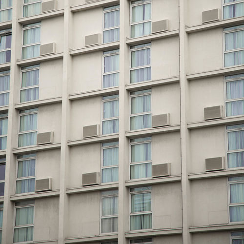 Apartment Architecture Backgrounds Building Building Exterior Built Structure City Day Full Frame Glass - Material In A Row Low Angle View Minimalism No People Outdoors Pattern Repetition Residential District Shape Side By Side Window