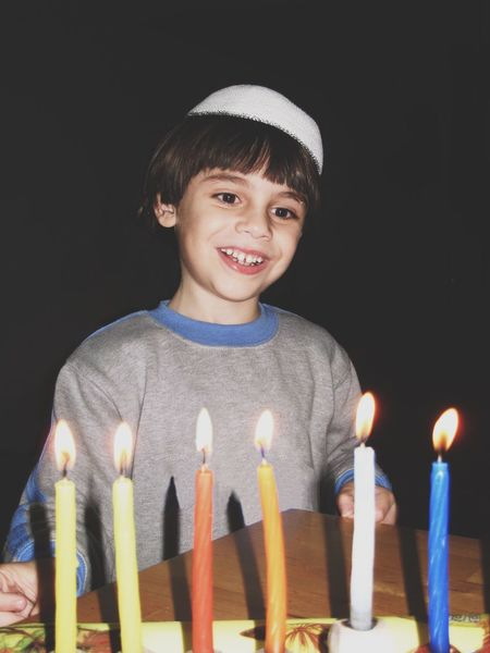 Holidays memories Hanukkah Portrait Looking At Camera Childhood Child One Person Real People Smiling Close-up People חנוכה מייגיא Holiday Holidays Candle Candlelight Candles Candle Light Lighting Chanukah
