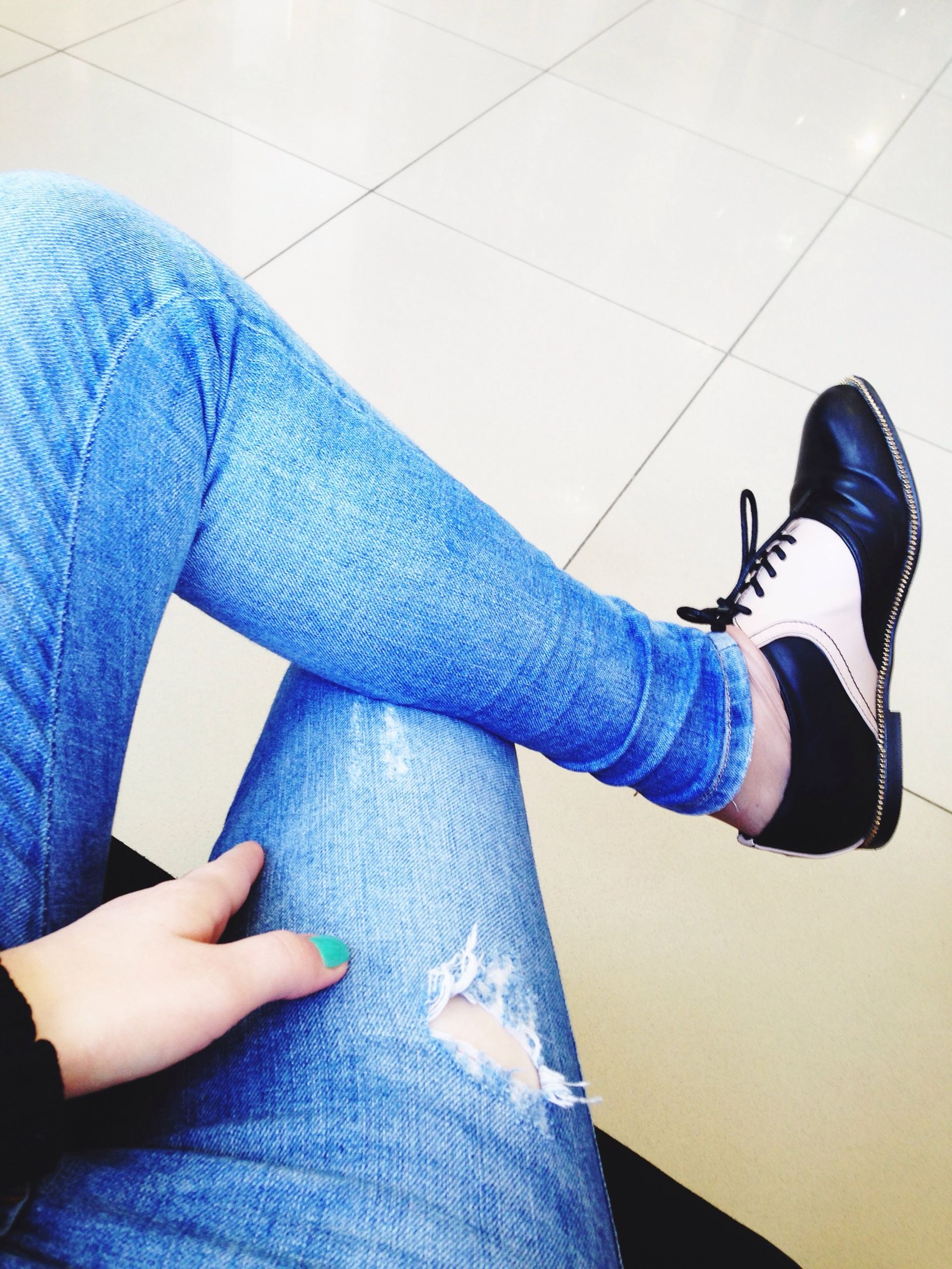 low section, person, lifestyles, shoe, indoors, jeans, leisure activity, men, human foot, sitting, casual clothing, blue, part of, personal perspective, footwear