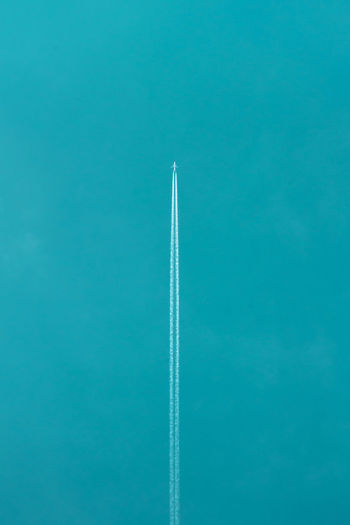 Airplane Flying Against Clear Blue Sky