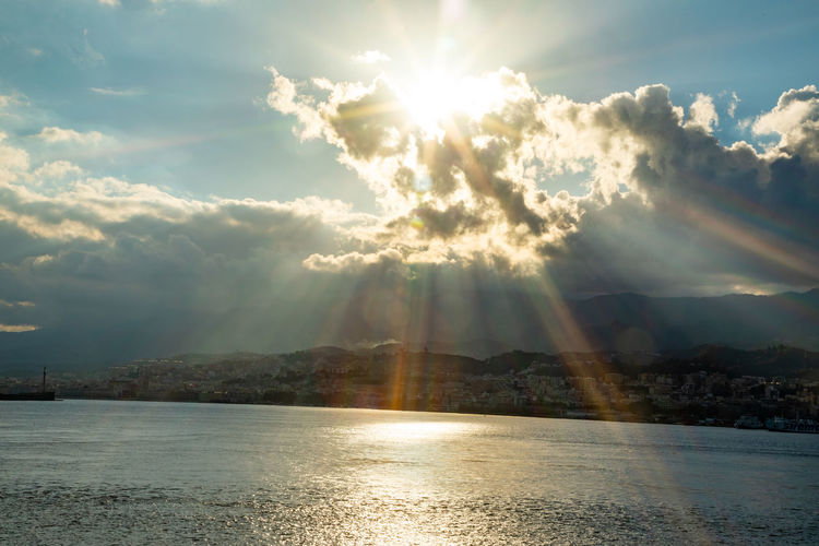 Messina Italy Sicily Ferry Sea Sky Water Cloud - Sky Beauty In Nature Sunbeam Scenics - Nature Sunlight Sun Tranquility Waterfront Tranquil Scene No People Nature Lens Flare Idyllic Day Reflection Non-urban Scene Outdoors Bright Streaming