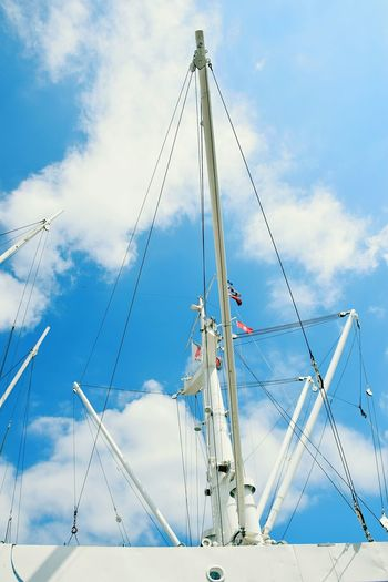 Nature Flags In The Wind  Beauty In Nature Sunlight Sunshine Outdoors Focus On Foreground Sky And Clouds Masts And Rigging Mast Blue Modern Complexity Tall - High