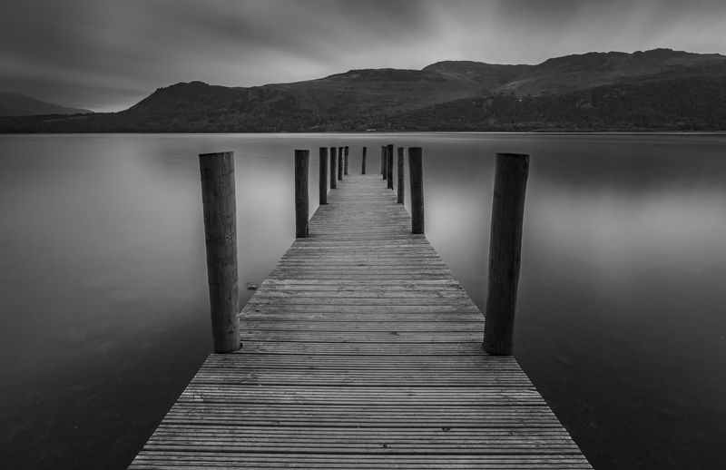 Moody Sky over Brandlehow Jetty - Cumbria Autumn Cumbria Derwent Water Dramatic Sky Heavy Rain Lake District Moody Sky Storm View Weather Winter Blackandwhite Brandlehow Clag Cloud - Sky Jetty Lake Long Exposure Monochrome No People Pier Seasons Sky Storm Cloud Water