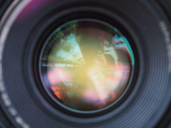 Camera lens. Camera - Photographic Equipment Photography Themes Lens - Optical Instrument Photographic Equipment Close-up Circle Geometric Shape Glass - Material Reflection Camera Lens Flare Optical Instrument Technology Lens - Eye