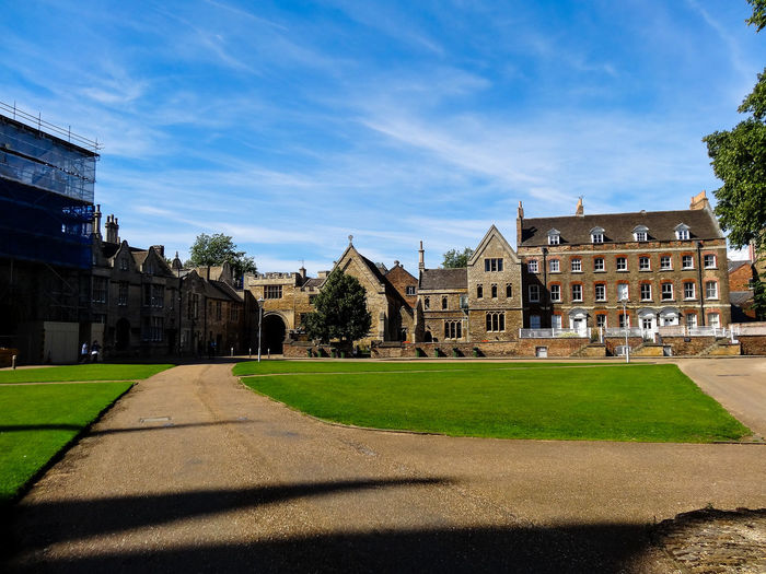 Architecture Building Exterior Built Structure Chapel Chimney Cloud - Sky Crossing Day Grass History House Lawn Outdoors Park Pathway Peterborough Renovation Scaffolding Shadow Sky Sunlight The Way Forward Tranquility Travel Destinations Tree