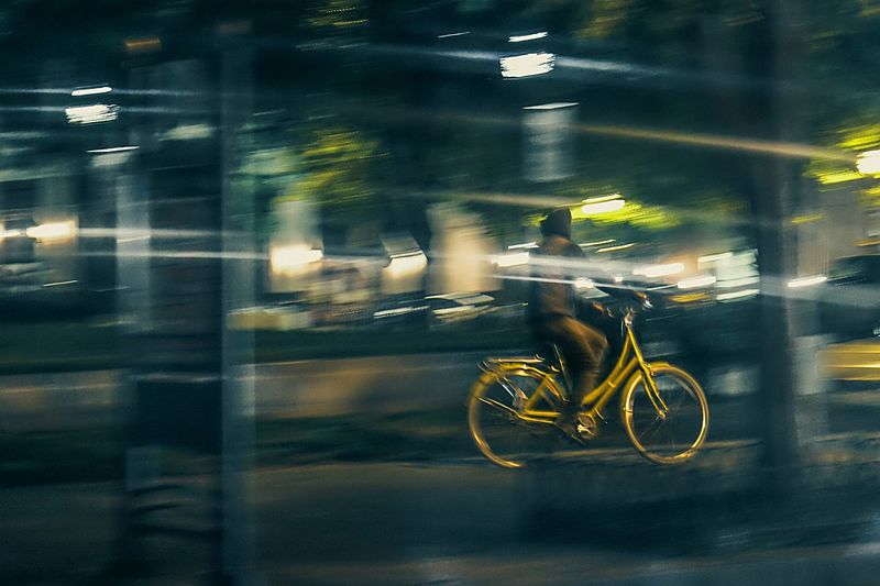 The Street Photographer - 2017 EyeEm Awards Blurred Motion Speed Transportation Mode Of Transport Motion Bicycle Land Vehicle Night Men City Yellow Motorcycle Road Real People Illuminated Outdoors Architecture One Person People The Street Photographer - 2017 EyeEm Awards Bicycles BYOPaper! Live For The Story Mix Yourself A Good Time