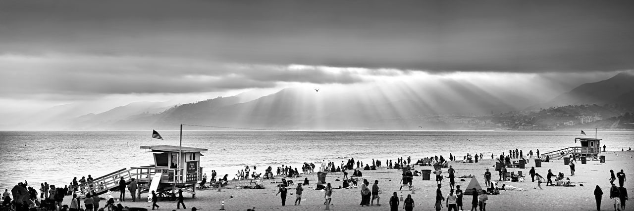 Beach Beachgoers Beauty In Nature Blackandwhite Cloud - Sky Day Horizon Over Water Landscape_photography Large Group Of People Lifeguard Tower Nature Nautical Vessel Outdoors Panoramic Photography People Rays Of Light Rays Of Sunshine Sand Sea Sky Summer Surfboard The Great Outdoors - 2017 EyeEm Awards Vacations Water
