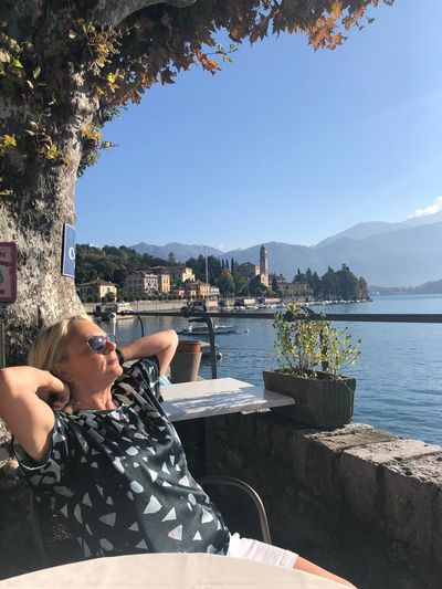 Chilling Lake Como Italy Relaxing Moments Water Real People Leisure Activity Lifestyles Nature Sunlight One Person Sky Portrait