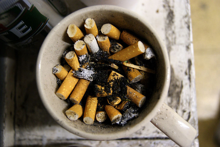 cigarette butts in a mug . When the ashtray goes missing in the Band rehearsal room Cigarette Butts Mug Ashtray  Band Rehearsal Addiction Cigarette Butt Bad Habit Smoking Issues Ashtray  Cigarette  No People Ash Close-up Danger