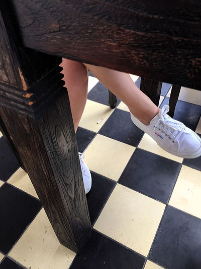 Resting and relaxing in a restaurant, on foot Adult Adults Only Close-up Day Human Body Part Human Leg Legs Below Table Low Section One Person One Woman Only Only Women Outdoors People Real People Relaxing Resting Sports Shoe Sports Shoes Superga Women