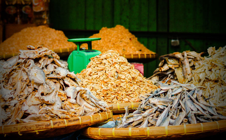 Salted dried fishes for sale in the local market Preserved Foods Salted Fish Dried Fishes & Anchovies Dried Fish  INDONESIA Indonesian Market Abundance Local Food Weighing Scale Food And Travel Travel Fishing Net No People Large Group Of Objects Day Outdoors Close-up Business Stories