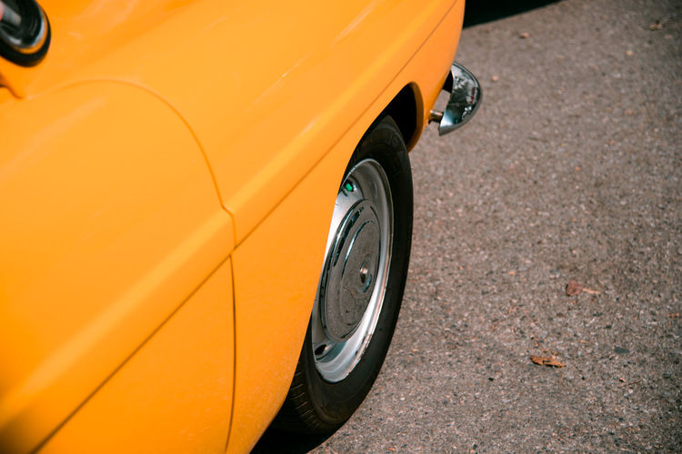 Close up yellow retro classic car Classic Retro Black Color Car City Close-up Day Land Vehicle Mode Of Transportation Motor Vehicle Nature No People Orange Color Outdoors Road Stationary Street Sunlight Tire Transportation Vintage Wheel Yellow