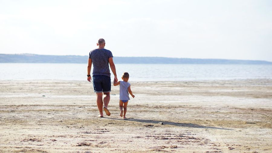Child Family Togetherness Beach Holding Hands Males  Walking Sand Parent Son Childhood Outdoors