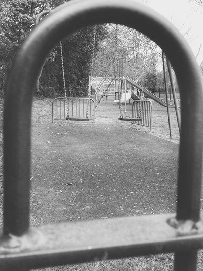 Empty Swing Playground Black And White Black & White View Through Railings