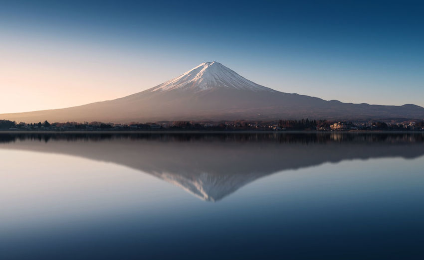 Mount Fuji in the early morning with reflection on the lake kawaguchiko Kawaguchiko Morning Mt.Fuji Beauty In Nature Clear Sky Day Lake Landmark Mountain Mountain Range Nature No People Outdoors Reflection Scenics Sky Sunrise Tranquil Scene Tranquility Travel Destinations Waterfront