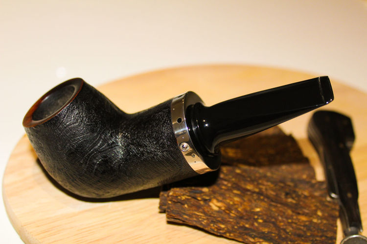 A favorite pipe of mine Pipe Smoking Close-up Hand Tool Indoors  Metal Pipe Pipe - Tube Pipes Table Wood - Material Work Tool