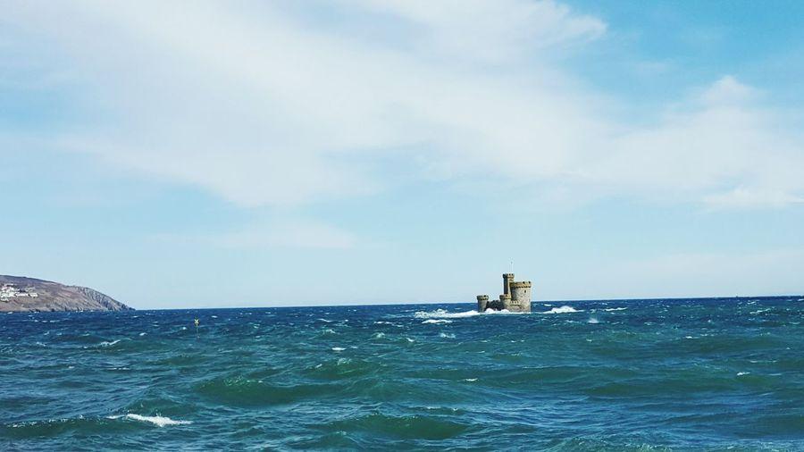 Isle of man amidst sea against sky