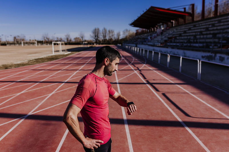 Side view of athlete standing on sports track