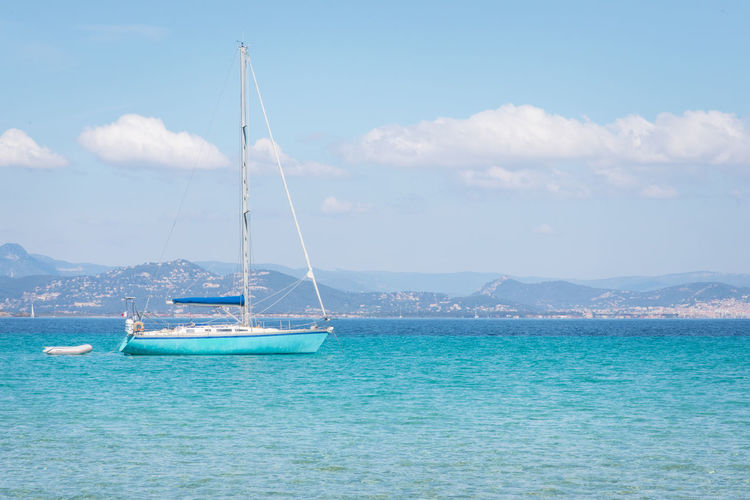 Sailing Sailboat Vacations Tourism Tourist Nautical Vessel Sea Water Transportation Sky Cloud - Sky Mode Of Transportation Waterfront Nature Beauty In Nature Scenics - Nature Day Tranquility Blue Tranquil Scene Travel Turquoise Colored No People Outdoors Yacht Luxury Yachting