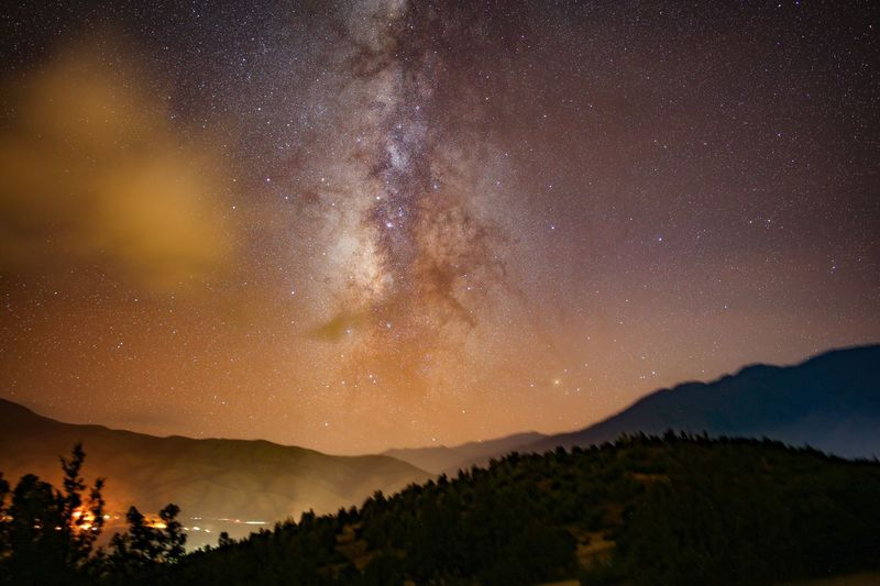 A few clouds and the Milky Way high in the Atlas Mountains. Atlas Mountains Mountain Star - Space Sky Night Scenics - Nature Astronomy Beauty In Nature Space Mountain Range Tranquility Environment Nature Galaxy Tranquil Scene No People Landscape Star Field Constellation Milky Way Idyllic