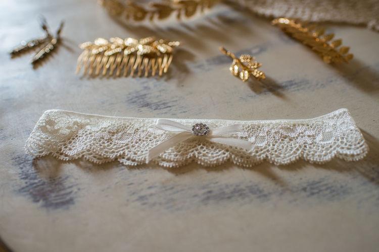 Close-up of garter belt on table