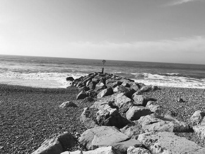 Coastal groynes EyeEm Selects Sea Horizon Over Water Beach Water Shore Nature Sky Pebble Beach Outdoors Rock - Object Beauty In Nature Day