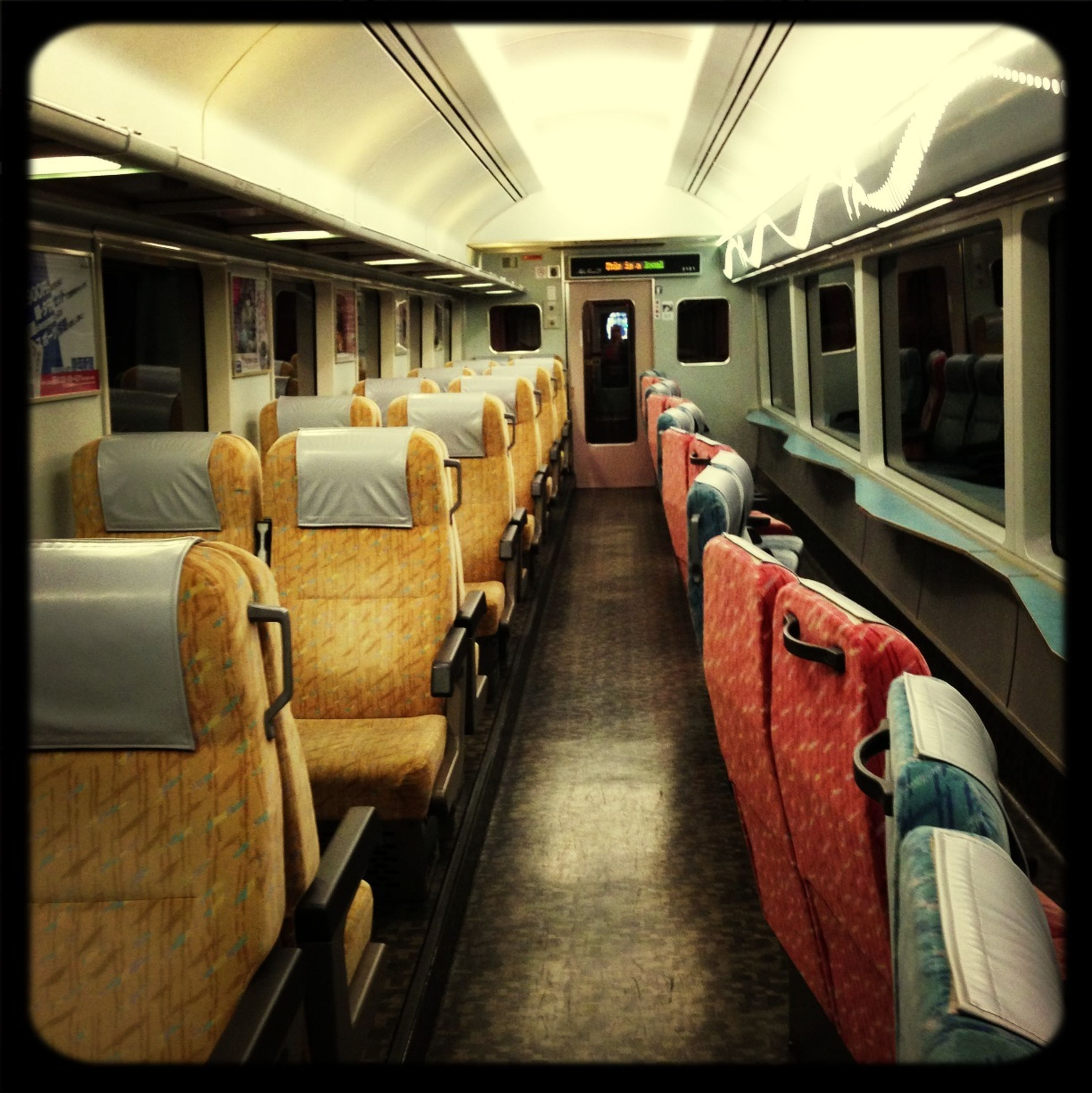 indoors, transportation, public transportation, mode of transport, vehicle seat, vehicle interior, train - vehicle, rail transportation, passenger train, train, travel, journey, public transport, railroad track, railroad station, bus, absence, railroad station platform, in a row, window